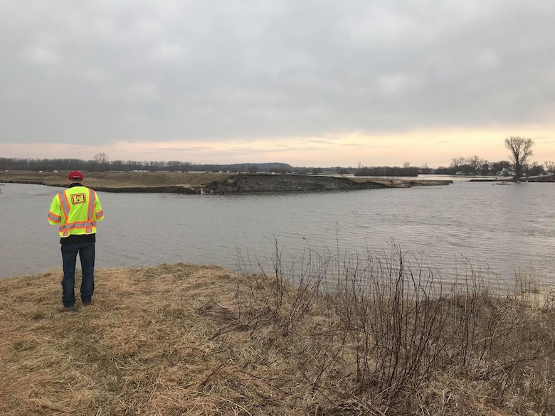A USACE, Omaha District employee assesses the area near breached levee L611 south of Council Bluffs, Iowa Mar. 29, 2019. (Photo by USACE, Omaha District)