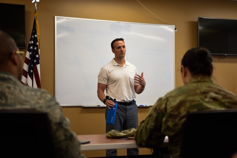 Dr. John Gassaway, Clinical Sports Psychologist with the Human Performance Team teaches participants of the Group Lifestyle Balance Program about SMART goals, March 26, 2019, at Luke Air Force Base, Ariz. Education classes are offered once a week and cover an array of nutritional topics such as healthy food choices, exercise tips and goal-setting guidance. (U.S. Air Force Photo by Senior Airman Monet Villacorte)
