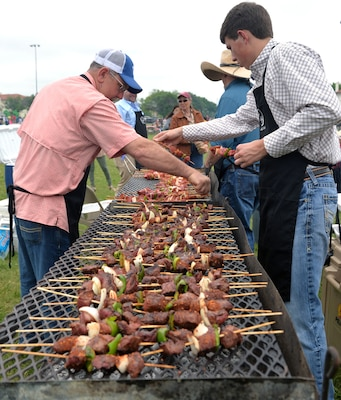 A long line of shish kebobs cooks for thousands of visitors to the annual Cowboys for Heroes chuckwagon event at Joint Base San Antonio-Fort Sam Houston March 30.