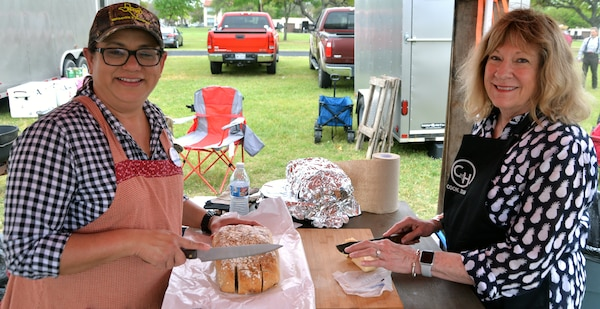Claudia Villarreal (left) and Becky Bike (right) prepare oatmeal bread for the Ellis CW chuckwagon, out of Goliad, Texas, at the annual Cowboys for Heroes chuckwagon event at Joint Base San Antonio-Fort Sam Houston March 30.
