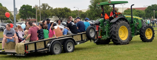 A family hayride was one way people could get around at the annual Cowboys for Heroes chuckwagon event at Joint Base San Antonio-Fort Sam Houston March 30.