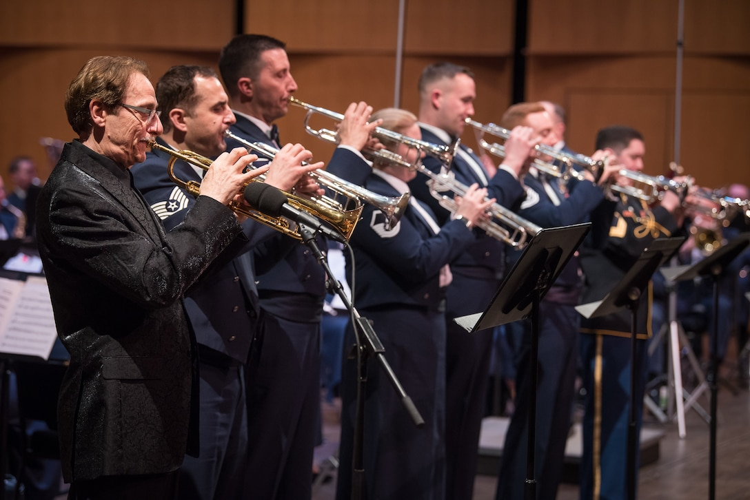 World-renowned trumpeter, Allen Vizzutti, left, lines up with the trumpet section on The United States Air Force Band's 2019 Guest Artist Series. The concert took place on Jan. 24, 2019, at the Rachel M. Schlesinger Concert Hall and Arts Center in Alexandria, Va. (U.S. Air Force photo by Chief Master Sgt. Kevin Burns)