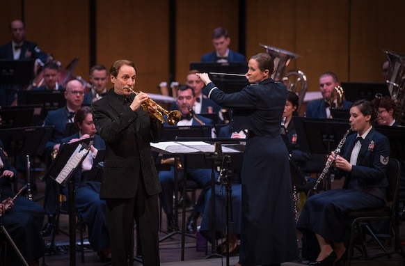 World-renowned trumpeter, Allen Vizzutti, left, performs on The United States Air Force Band's 2019 Guest Artist Series. The concert took place on Jan. 24, 2019, at the Rachel M. Schlesinger Concert Hall and Arts Center in Alexandria, Va. (U.S. Air Force photo by Chief Master Sgt. Kevin Burns)