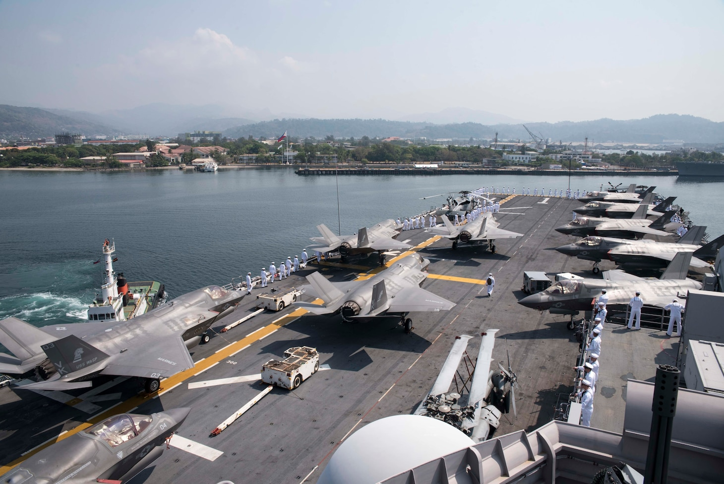 SUBIC BAY, PHILIPPINES (March 30, 2019) – Sailors aboard the amphibious assault ship USS Wasp (LHD 1) prepare to man the rails prior to arriving to Subic Bay in preparation of Exercise Balikatan. Exercise Balikatan, in its 35th iteration, is an annual U.S., Philippine military training exercise focused on a variety of missions, including humanitarian assistance and disaster relief, counter-terrorism, and other combined military operations.