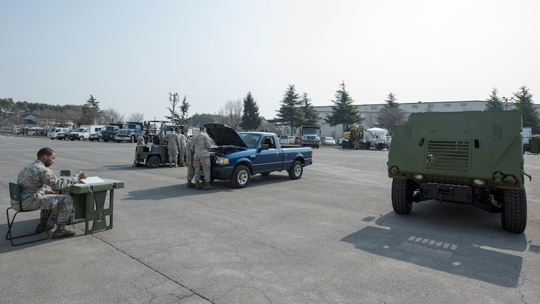 Airmen with the 35th Logistic Readiness Squadron work on inoperable vehicles during the first LRS Agile Combat Employment exercise at Misawa Air Base, Japan, March 20, 2019. The primary objective of the exercise was to fix a small pickup truck and a standard fork lift with an array of mechanical issues while having a limited number of tools to work with, similar to the work environment 35th LRS Airmen would face in a real-world evacuation or expeditionary setting (U.S. Air Force photo by Airman 1st Class Collette Brooks)