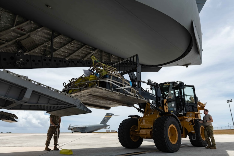 U.S. Air Force Airmen load a pallet onto a C-17 Globemaster III at Andersen Air Force Base, Guam, during exercise Resilient Typhoon, April 23, 2019. The exercise was designed to practice dispersal operations from Andersen to airfields throughout Micronesia. (U.S. Air Force photo by Airman 1st Class Matthew Seefeldt)