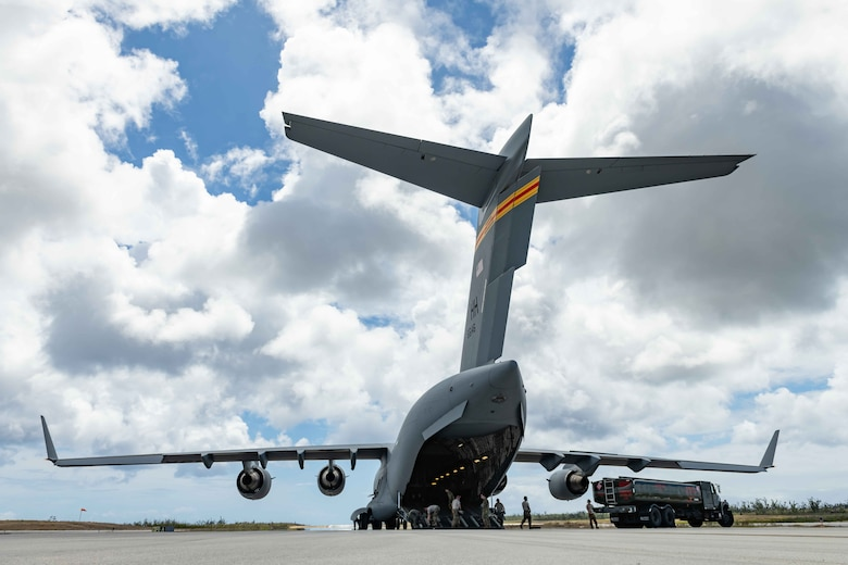 U.S. Air Force Airmen unload a fuel truck from a C-17 Globemaster at Tinian International Airport, Tinian, during exercise Resilient Typhoon, April 23, 2019. The exercise was designed to increase Pacific Air Forces' ability to rapidly deploy and operate from airfields throughout the region.  (U.S. Air Force photo by Airman 1st Class Matthew Seefeldt)