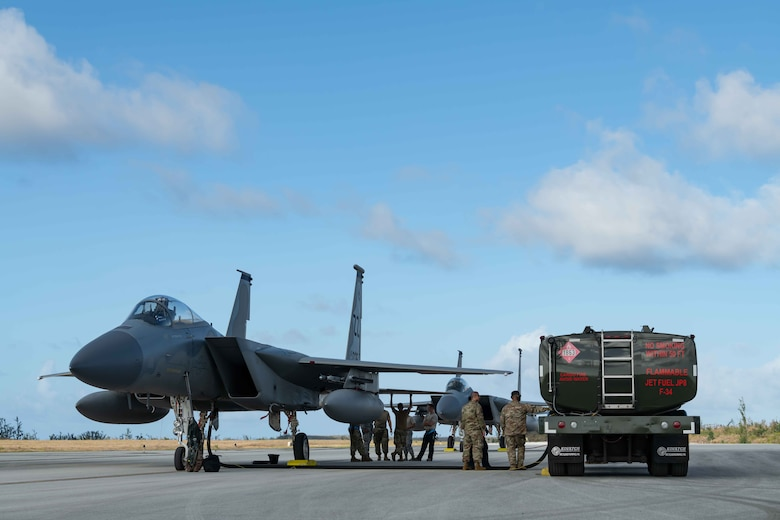 An F-15C Eagle from the 44th Fighter Squadron, Kadena Air Base, Japan, gets refueled at Tinian International Airport, Tinian, during exercise Resilient Typhoon, April 23, 2019.  The aircraft dispersal exercise, based from Andersen Air Force Base, Guam, empowered Airmen at the tactical level to employ new approaches to operations in order to increase resiliency and readiness.  (U.S. Air Force photo by Airman 1st Class Matthew Seefeldt)