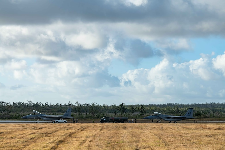 Two F-15C Eagles from the 44th Fighter Squadron, Kadena Air Base, Japan, sit on the taxiway at Tinian International Airport, Tinian, during exercise Resilient Typhoon, April 23, 2019.  The aircraft dispersal exercise, based from Andersen Air Force Base, Guam, empowered Airmen at the tactical level to employ new approaches to operations in order to increase resiliency and readiness.  (U.S. Air Force photo by Airman 1st Class Matthew Seefeldt)
