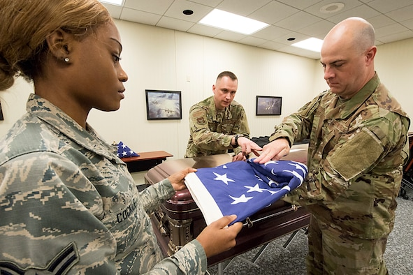 Master Sgt. Michael Swick, 17th Airlift Wing Honor Guard member, works with 434th Air Refueling Wing members Airman 1st Class. Alexis Cockle, Master Sgt. Adam Reynolds, and Tech. Sgt. Ryan Turpen, during a training class held March 29, 2019 at Grissom. The Honor Guard is working to expand membership to support a variety of details. (U.S. Air Force photo/Douglas Hays)