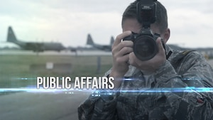 Airman taking photo.