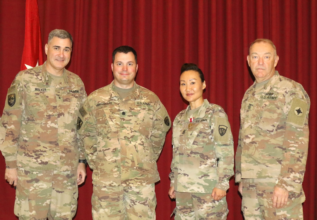 Brig. Gen. Clint E. Walker, commanding general of 184th Sustainment Command, Lt. Col. Leo Karanikolas, 420th Transportation Battalion, 1st Sgt. Sun Lee, 420th, and Command Sgt. Maj. Jason Little, 184th, after a transfer of authority ceremony at Camp Arifjan, Kuwait, April 25, 2019. The Sherman Oaks, Calif. based 420th officially transfers authority of the theater movement control battalion mission to the Manhattan, Kan. based 450th Transportation Battalion on April 28, 2019.