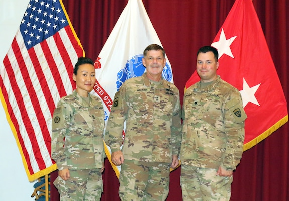 "1st Sgt. Sun Lee, 420th Transportation Battalion, Maj. Gen. Flem B. ""Donnie"" Walker, commanding general of 1st Theater Sustainment Command, and Lt. Col. Leo Karanikolas, 420th Transportation Battalion,  at Camp Arifjan, Kuwait, April 25, 2019"