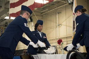 Color guard team conducting missing man table ceremony.