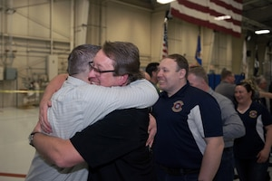 Airman receiving hug.