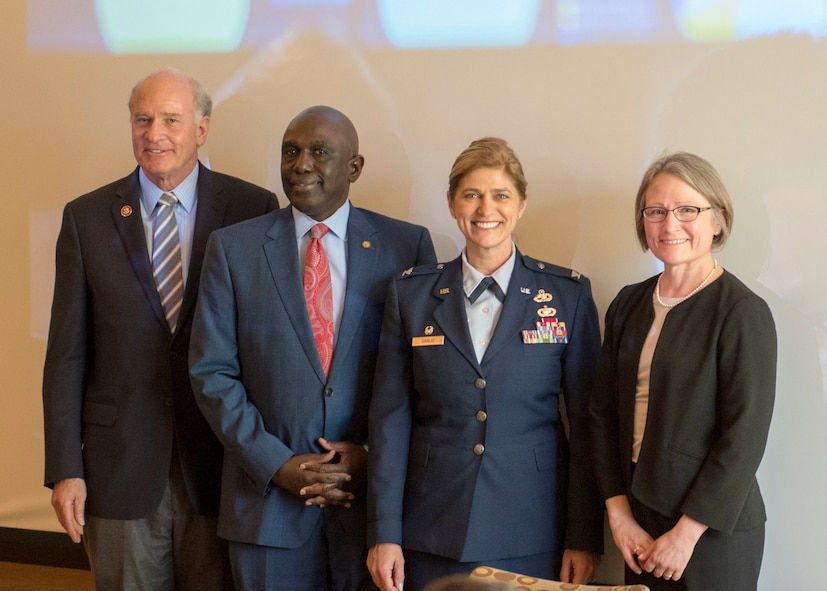 Congressman William Keating, UMass Chancellor Robert E. Johnson, 102nd Intelligence Wing Commander Virginia I. Gaglio and Dean of the UMass Dartmouth's College of Engineering Dr. Jean VanderGheynst stand next to each other smiling for the camera.