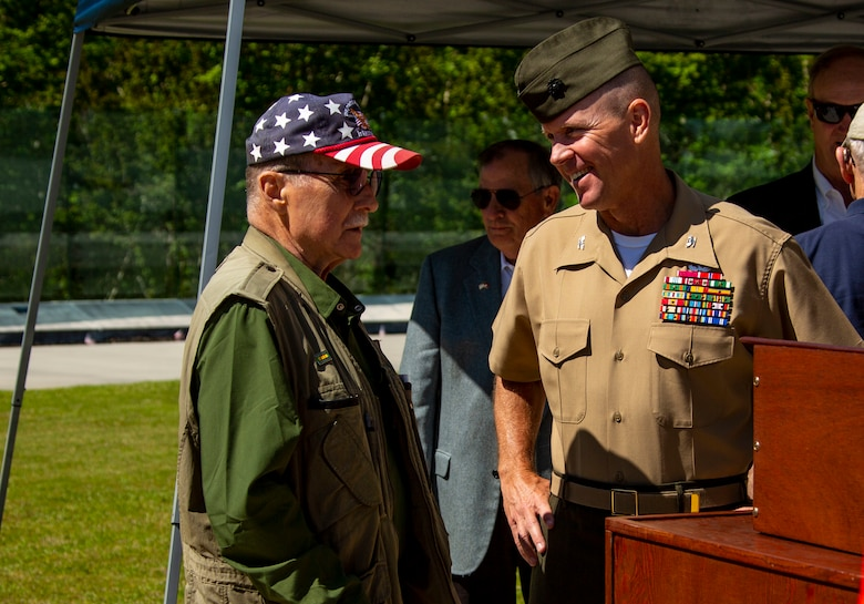 U.S. Marine Corps Col. Scott A. Baldwin, deputy commander, Marine Corps Installations East-Marine Corps Base Camp Lejeune, speaks with retired Marine Col. Paul Davenport during the Vietnam Veterans Recognition Day Ceremony at the Onslow Vietnam Veterans Memorial, Lejeune Memorial Gardens, Jacksonville, North Carolina, April 27, 2019. The ceremony honored the memory of those who died during the war and celebrated the accomplishments and perseverance of Vietnam-era veterans. (U.S. Marine Corps Photo by Lance Cpl. Isaiah Gomez)