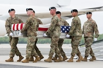 Photo of dignified transfer of Pfc. Michael A. Thomason