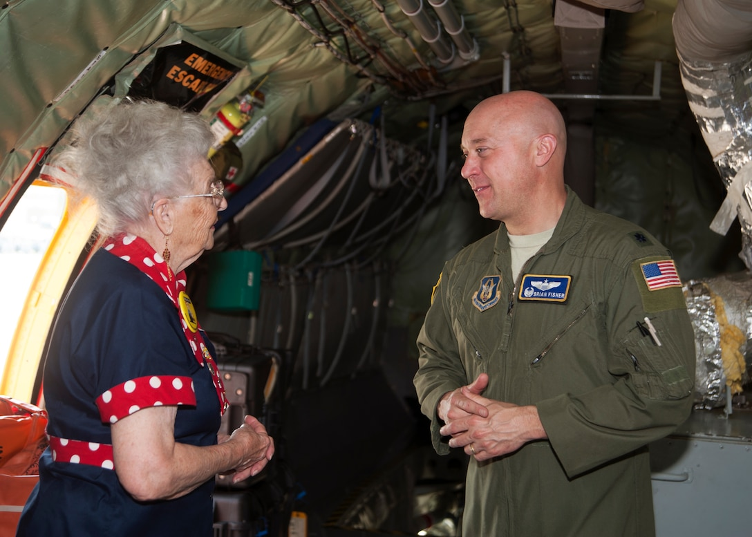 "Mae Krier, an original ""Rosie the Riveter"" who helped build B-17s and B-29s during WWII, speaks to Lt. Col Brian Fisher, 756th Air Refueling Squadron commander, while on a tour at the 459th Air Refueling Wing at Joint Base Andrews, Md., April 30, 2019. Krier led a successful campaign for National Rosie the Riveter Day which led to a unanimous Congressional approval in 2017. It is now observed during Women's History Month on March 21. (U.S. Air Force photo by Staff Sgt. Cierra Presentado)"