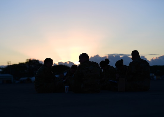 Airmen from the 911th Aeromedical Evacuation Squadron sit and study at Barbers Point Airfield, Hawaii April 26, 2019. The 911th AES trained throughout the week and went over ground procedures as well as in air medical procedures. (U.S. Air Force Photo by Senior Airman Grace Thomson)
