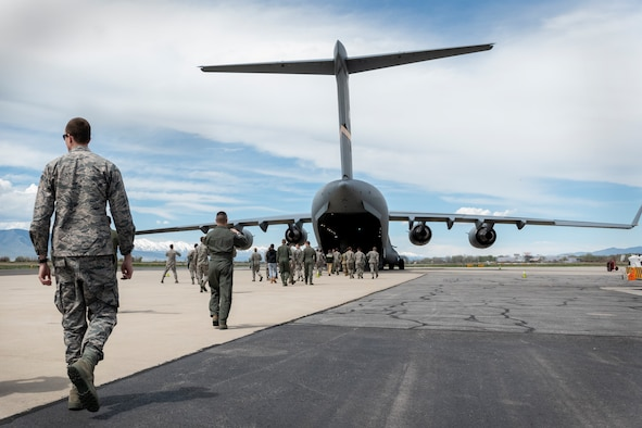 ROTC cadets walk towards a C-17 Globemaster III assigned to the 97th Air Mobility Wing, April 20, 2019, Provo, Utah. The cadets were given the opportunity to ride in a C-17 as a recruiting opportunity so they could understand more of what pilots do on a regular basis. (U.S. Air Force photo by Airman 1st Class Jeremy Wentworth)
