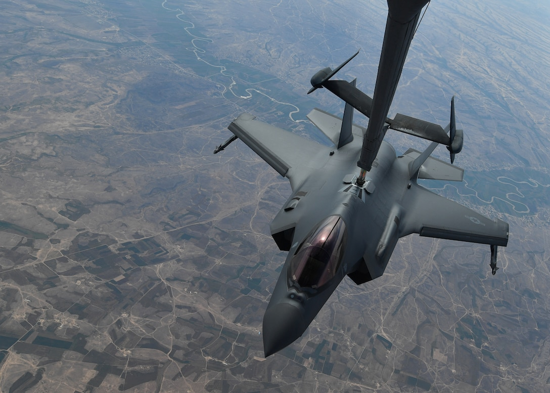 A U.S. Air Force KC-10 Extender refuels an F-35A Lightning II above an undisclosed location, April 30, 2019. The KC-10 and its crew were tasked to support aerial refueling operations for the F-35A's first air interdiction during its inaugural deployment to the U.S. Air Forces Central Command's area of responsibility. (U.S. Air Force photo by Staff Sgt. Chris Drzazgowski)