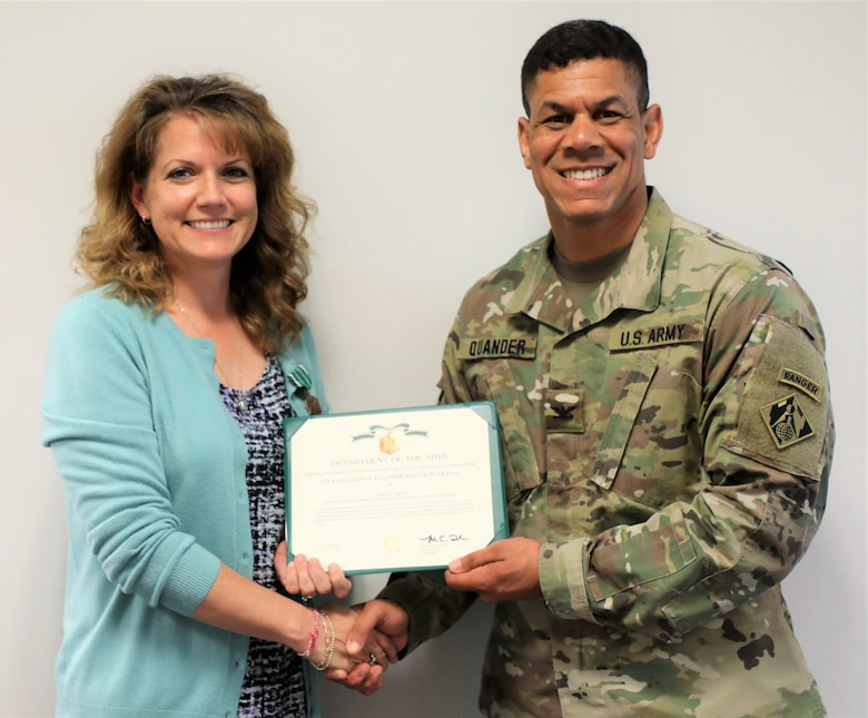 Transatlantic Division Commander Col. Mark C. Quander, presents the Civilian Service Commendation Medal to Bahrain Contracting Officer Andrea Greene, during a ceremony held at the TAD headquarters in Winchester, Va., on April 25, 2019. Quander lauded Greene for her work ethic and customer-focused performance, supporting individuals living and working overseas in Bahrain.