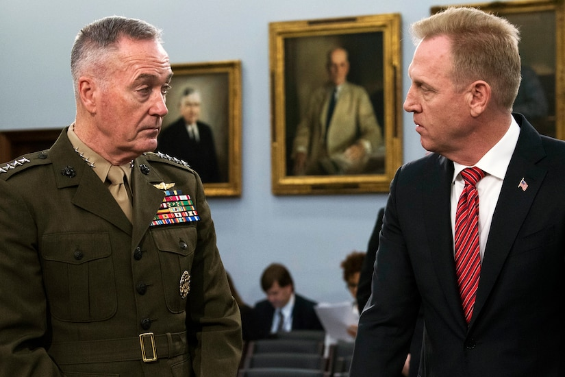 Two defense leaders speak together .