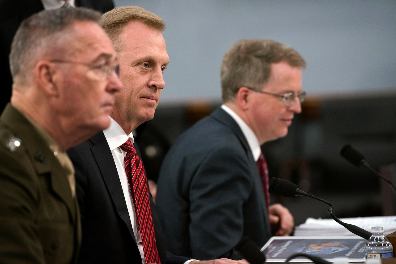 Marine Corps Gen. Joe Dunford Jr., Acting Defense Secretary Patrick M. Shanahan and David L. Norquist sit at a table.