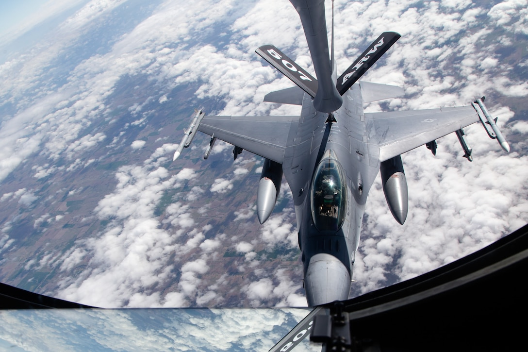 A 138th Fighter Wing F-16 Fighting Falcon from Tulsa Air National Guard Base, Oklahoma, refuels from a KC-135R Stratotanker April 25, 2019. The Stratotanker, from the 507th Air Refueling Wing at Tinker Air Force Base, Oklahoma, refueled four 138th Fighter Wing F-16 Fighting Falcons during flight operations over Kansas. (Courtesy photo by Mike Killian)