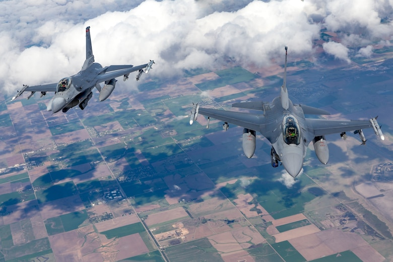 Two 138th Fighter Wing F-16 Fighting Falcons from Tulsa Air National Guard Base, Oklahoma, fly behind a KC-135R Stratotanker April 25, 2019. The Stratotanker, from the 507th Air Refueling Wing at Tinker Air Force Base, Oklahoma, refueled four 138th Fighter Wing F-16 Fighting Falcons during flight operations over Kansas. (Courtesy photo by Mike Killian)