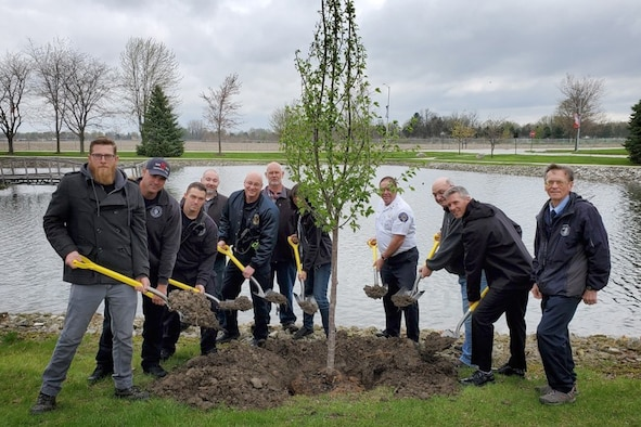 Grissom personnel pose for a photo during a special Arbor Day ceremony held here April 26, 2019. Each year Arbor Day is celebrated on the last Friday of April. Its celebration provides an opportunity to learn about trees and take positive action to make the world a better place. (U.S. Air Force photo/Master Sgt. Ben Mota)
