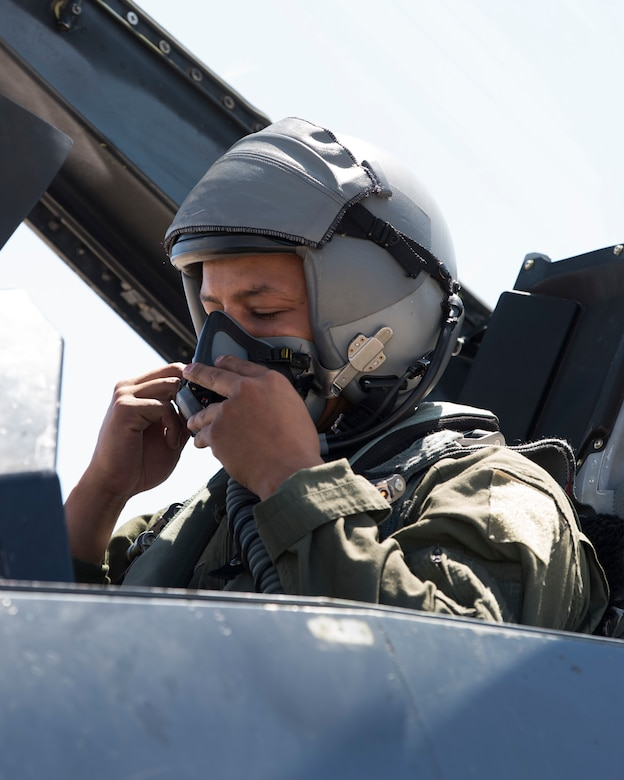 Airman 1st Class Mequail Fridge, 311th Aircraft Maintenance Unit crew chief, dons his helmet before a familiarization flight, April 25, 2019, on Hill Air Force Base, Utah. The 311th Fighter Squadron had a goal of eight familiarization flights per day for operations and maintenance personnel during exercise Venom 19-01. (U.S. Air Force photo by Staff Sgt. BreeAnn Sachs)