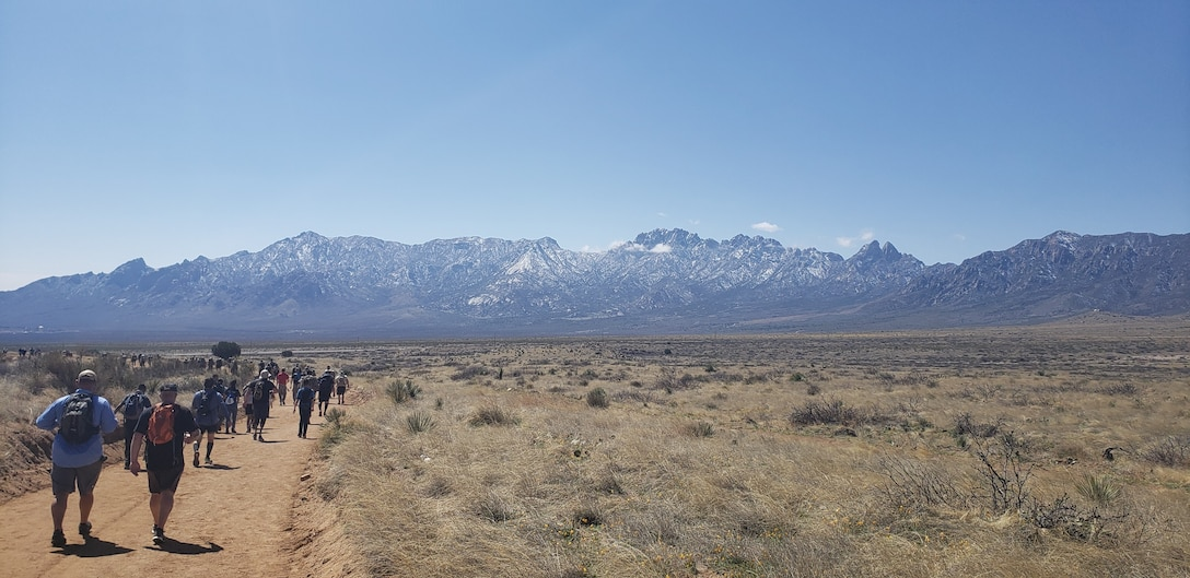 Mountains can be seen as the team marches, March 17, 2019.
