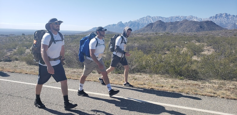 (l-r): Albuquerque District team members Kevin Vigil, Adam Baros, and Dakota Brodie participate in the 2019 Bataan Memorial Death March, March 17, 2019.