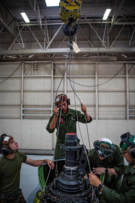 HMLA-469 Marines conduct helo maintenance