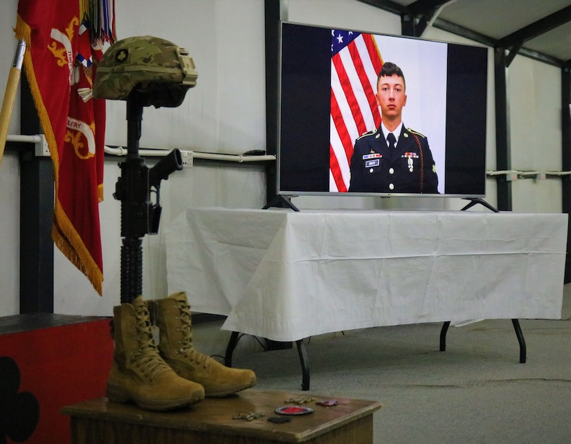 Identification tags for Spc. Ryan Riley hang from the Fallen Soldier Cross during a unit memorial service in Qayyarah West Airfield, Iraq, April 25, 2019. The Fallen Soldier Cross, also known as a Battle Cross, dates back to at least the American Civil War as a means of identifying the location of fallen Soldiers on the field. Today it is often a means of showing respect for the dead among the living members of the unit.