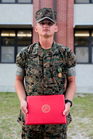 Lance Cpl. Caleb Eudy, with Charlie Company, 1st Recruit Training Battalion, is awarded a Navy and Marine Corps Achievement Medal on Parris Island, S.C. April 26, 2019.