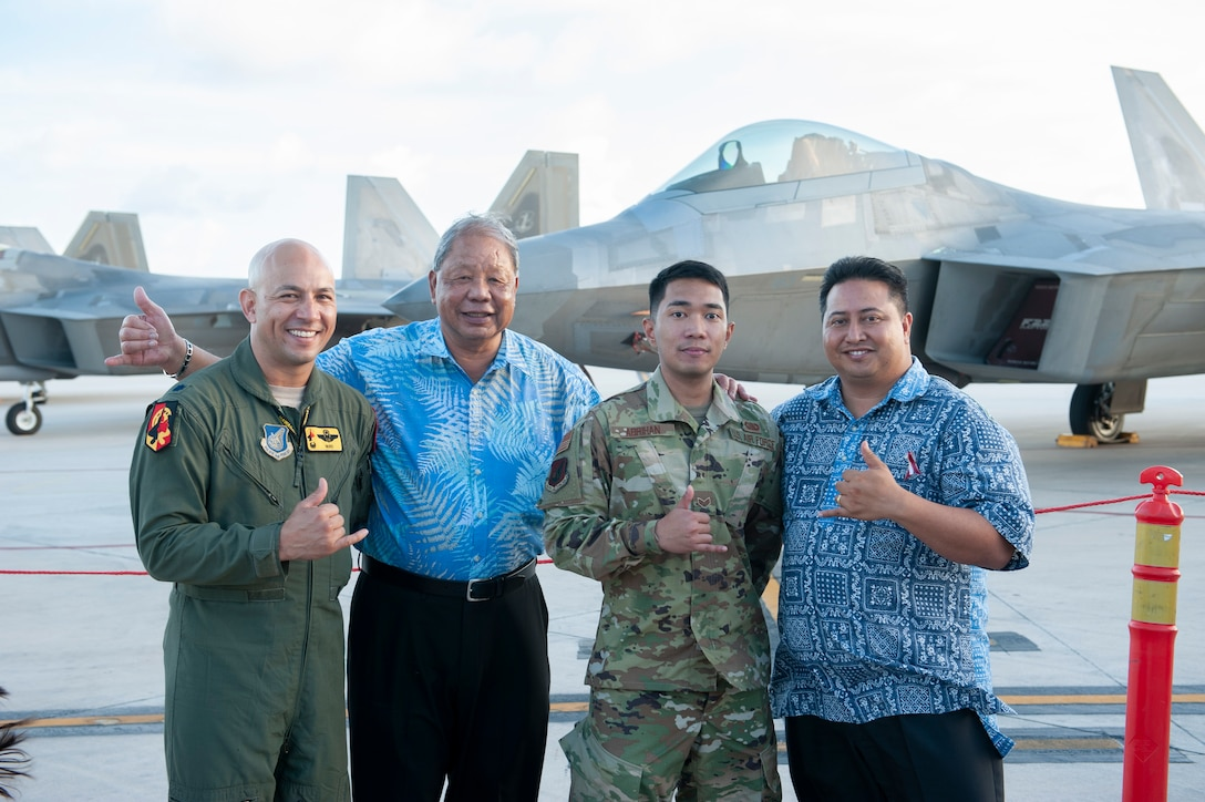 Lt. Col. Shane Nagatani, 199th Fighter Squadron commander, David M. Apatang, Saipan Mayor, Senior Airman Mark Abriham, 36th Communications Squadron radio technician, and Ralph Torres, Governor of Saipan, gather during an F-22 static display tour April 23, 2019, at the Francisco C. Ada International Airport, Saipan. Abriham, a Saipan native, returned home on military orders and supported the 'Hawaiian Raptors' during their inaugural visit to his home island. The movement of F-22 Raptor aircraft was part of the Pacific Air Forces exercise Resilient Typhoon, designed to prepare aircraft and personnel to disperse in the face of inclement weather. (U.S. Air National Guard photo by Senior Airman John Linzmeier)