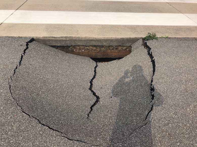 A 7 feet by 8 feet sinkhole was discovered on the runway at Kunsan Air Base, Republic of Korea, May 2, 2019. The 8th Civil Engineer Squadron and 8th Logistics Readiness Squadron made the flight line operational again just 24 hours after it was shut down to repair a sinkhole. (Courtesy photo)