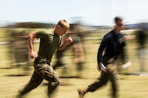 U.S. Marines with 3rd Battalion, 12th Marine Regiment, 3rd Marine Division, undergo an oleoresin capsicum spray course during the Artillery Relocation Training Program 19-1 at the Combined Arms Training Center, Camp Fuji, Japan, April 28, 2019. The course requires Marines to complete various physical tasks while under the effects of OC spray in order to prepare for potential real-life scenarios.