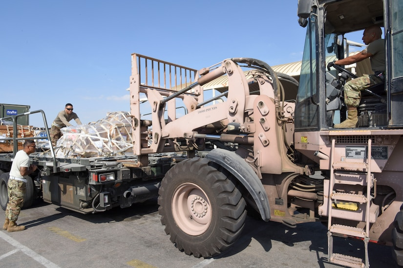 Troops load a truck.