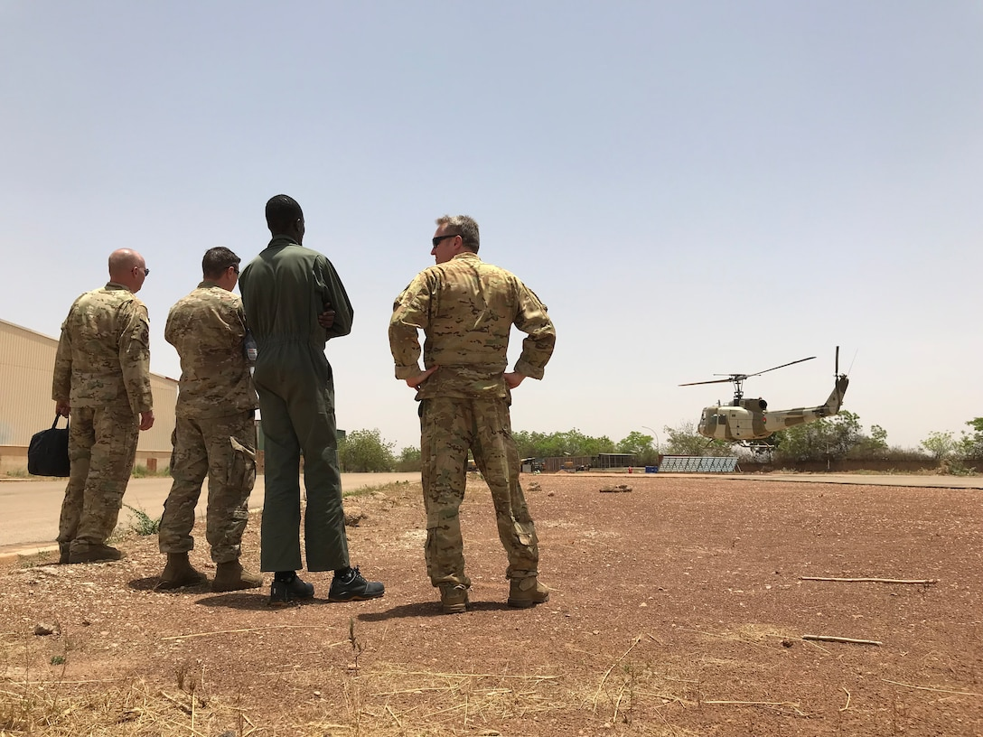 Air Advisors observe a hover check by the Burkina Faso Air Force at Airbase 511 in Burkina Faso, Africa, April 10, 2019. The 818 MSAS sent a seven member Rotary Wing Maintenance and Operations mobile training team to identify the cause of a significant maintenance issue that had grounded the Burkina Faso Air Force's UH-1H helicopter fleet for nearly a year. (U.S. Air Force photo by Master Sgt. Sarah Colwell)