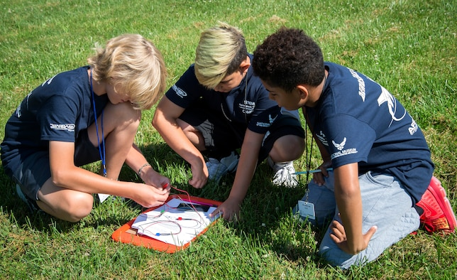 From left, STEM Aerospace campers Sam Theil, Rylen Dellinger and Alex Grubb explore solar energy in a hands on activity at a two-day STARBASE camp July 11, 2018. (U.S. Air Force photo by Karina Brady)