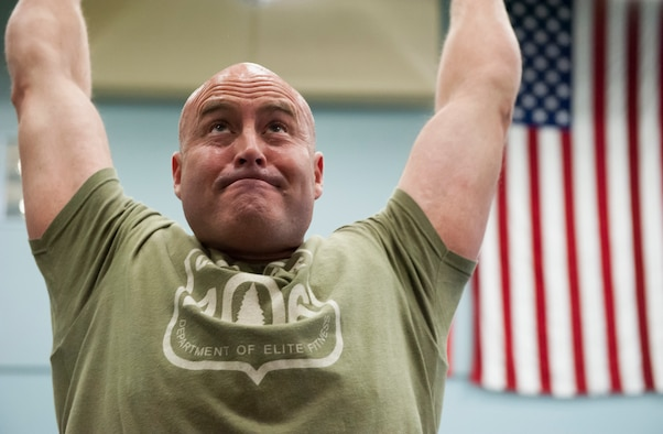 "Scott Johns, 341st Civil Engineering Squadron fire fighter, does a pull-up during a ""Wing One"" fitness class April 29, 2019, at Malmstrom Air Force Base, Mont."