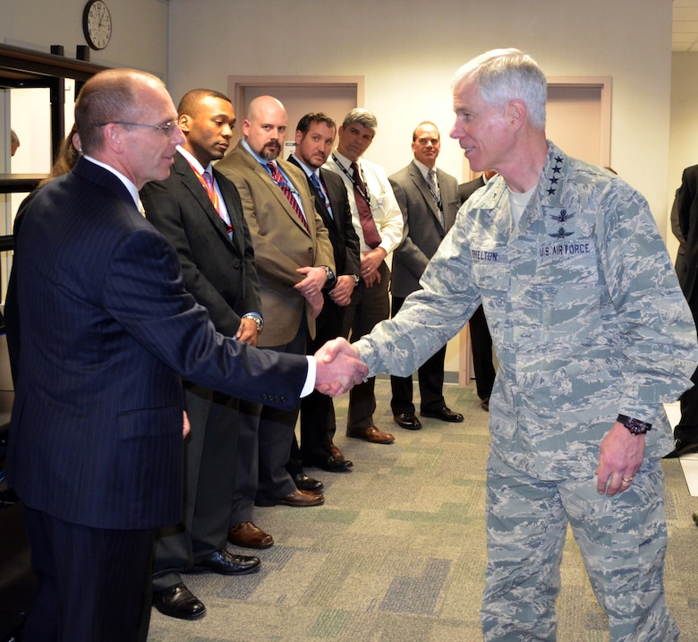 Gen. William L. Shelton meets members of the Air Force Network Integration Center migration project management team March 31, 2014, during his visit at Scott Air Force Base, Ill. During his visit, Shelton met the people who were integral to migrating user accounts onto the AFNET. Shelton is the Air Force Space Command commander. (U.S. Air Force photo/ Shelly Petruska)