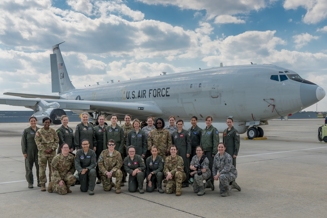 Female aircrew and support members from the U.S. Air Force 116th Air Control Wing, Georgia Air National Guard, the 461st Air Control Wing, and Army JSTARS pose for a group photo in front of an E-8C Joint STARS after returning from a training mission at Robins Air Force Base, Ga., Mar. 21, 2019.
