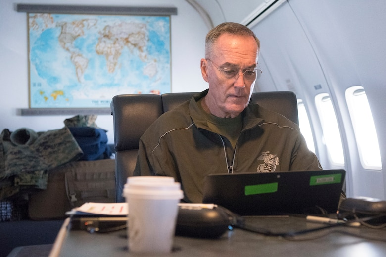 Marine Corps Gen. Joseph F. Dunford Jr., chairman of the Joint Chiefs of Staff, works in his cabin aboard a C-32 aircraft after departing Fort Greeley, Alaska, Aug. 19, 2017. (DOD photo by U.S. Navy Petty Officer 1st Class Dominique A. Pineiro)