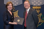 David L. Norquist, performing the duties of deputy secretary of defense, presents Lisa Hershman, acting chief management officer, the DOD Gears of Government Award for her DOD Regulatory Reform Task Force team at the Pentagon, May 1, 2019.