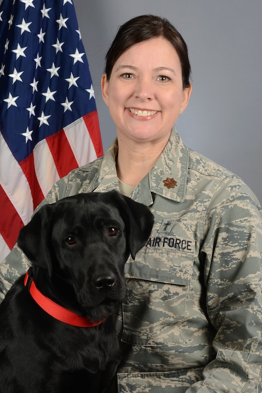 Portrait of U.S Air Force Maj. Christina Pittman, the 169th Fighter Wing chaplain, along with Avalon, the therapy assistance dog for ministry at McEntire Joint National Guard Base, South Carolina Air National Guard, March 19, 2019. (U.S. Air National Guard photo by Master Sgt. Caycee Watson)